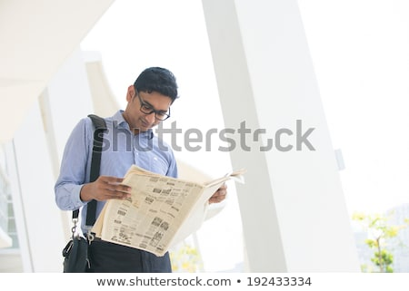 Businessman reading a newspaper outside an office building Stock photo © photography33