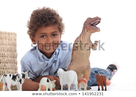 Young boy playing with a toy dinosaur and collection of domestic animals Stock photo © photography33