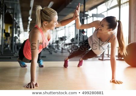 nők · tornaterem · testmozgás · tányér · tükör · póló - stock fotó © photography33