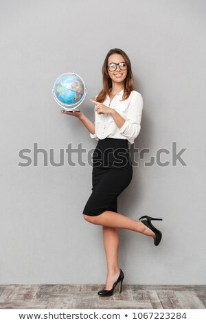 Young businesswoman holding a globe stock photo © photography33