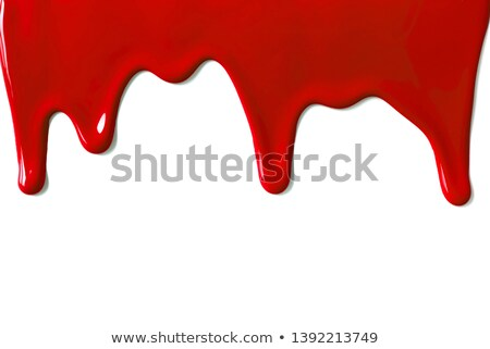 close up of red paint leaking on white background stock photo © inxti