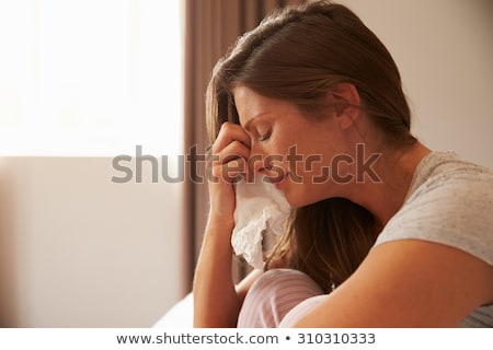 woman crying with a tissue stock photo © photography33