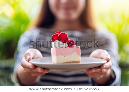 Person gives to young woman meal on a plate Stock photo © pzaxe