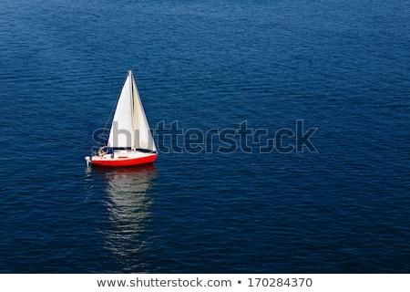 Yalnız kırmızı mavi deniz Stok fotoğraf © timwege