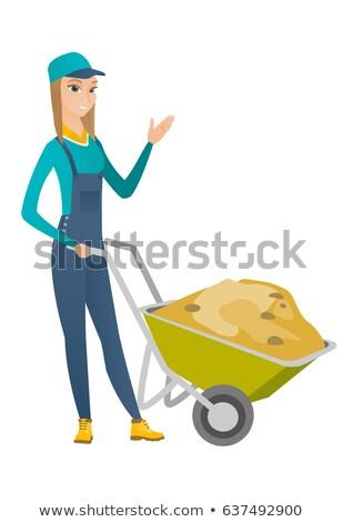 Feminino trabalhador carrinho de mão sorrir jardim jovem Foto stock © photography33