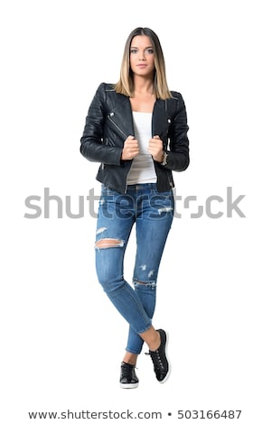 Csinos fiatal nő fekete szoros farmer izolált Stock fotó © acidgrey