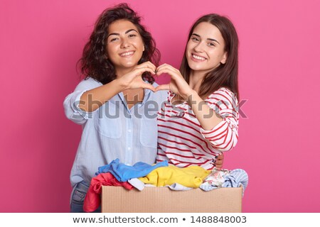 Stock photo: a girl showing a heartshaped box