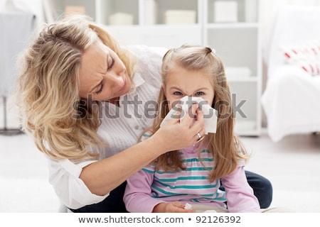 Human child cold flu illness tissue blowing nose  Stock photo © dacasdo