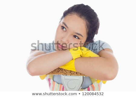 Troubled woman leaning on a mop in her apron  Stock photo © wavebreak_media