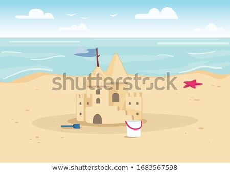 Homokvár tengerparti homok kastély tengerpart égbolt víz Stock fotó © carodi