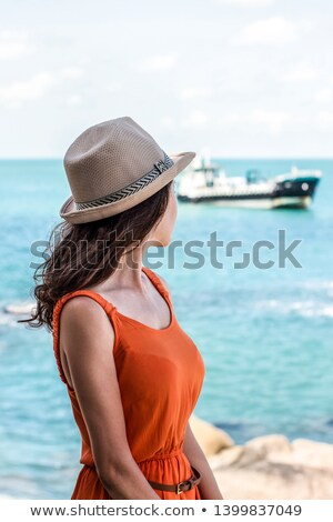 Young Girl Looking off in the distance on a bright, sunny day. Stock photo © mikecharles