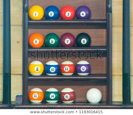 billiard pool stick with red balls row stock photo © lunamarina