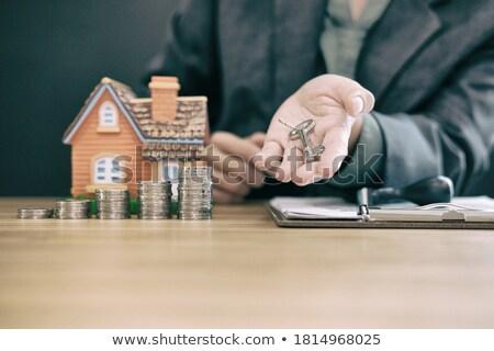 keys of dwelling on money stack Stock photo © Mikko
