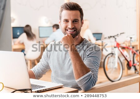 young casual man with hand on his chin Stock photo © feedough
