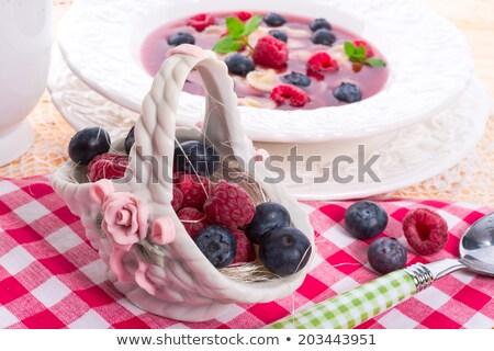 porzelan basket with raspberry and bilberry  Stock photo © Dar1930
