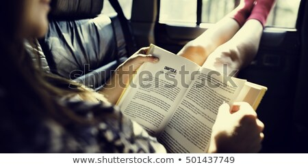 Woman reading a book in the car Stock photo © d13