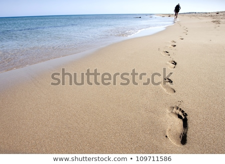 Footprints in the sand coastal image Stock photo © jenbray