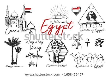 Egypt pyramids and sphinx from sand on beach Stock photo © Mikko