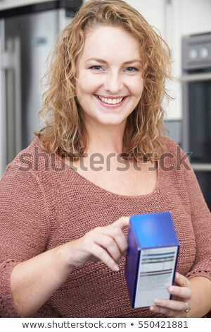 Plus Size Female Reading Nutritional Information On Packet Stock photo © HighwayStarz