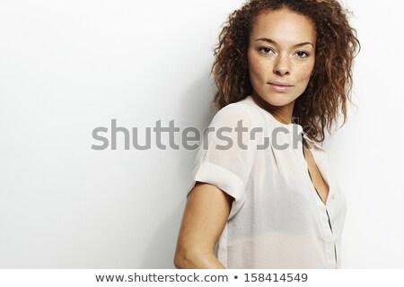 csábító · fiatal · nő · szürke · néz · kamera · közelkép - stock fotó © stryjek