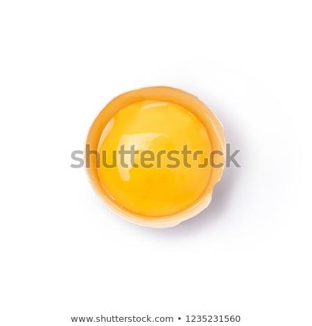 Huevo yema de huevo primer plano blanco superior vista Foto stock © mady70