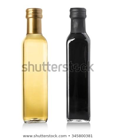 extra olive oil two bottles isolated stock photo © marimorena