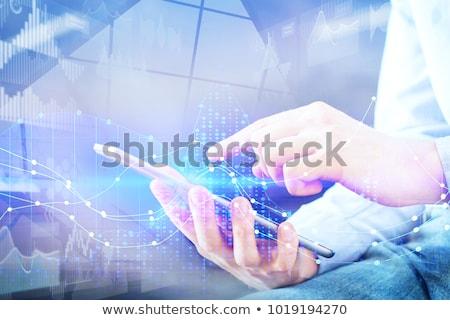Stock photo: Man pointing at digital tablet