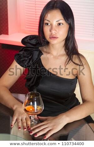 Vidrio brandy hermosa vestido sofá casa Foto stock © ssuaphoto