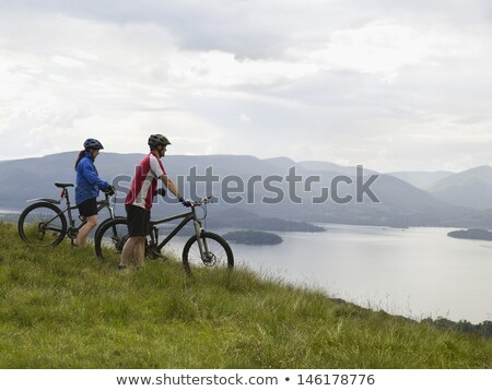 Active couple cycling in the countryside looking to the side Stock photo © wavebreak_media
