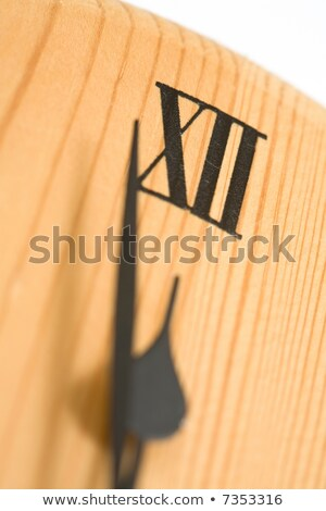 Close-up clock with Roman numerals striking twelve o'clock Stock photo © Noedelhap
