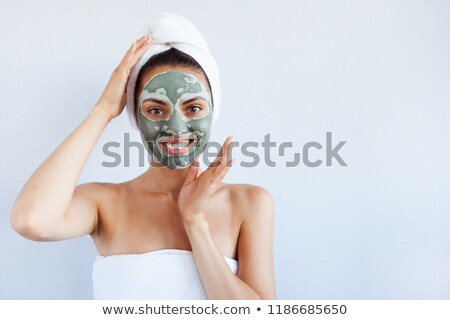 young woman applying a mask for the face of the therapeutic blac stock photo © dashapetrenko