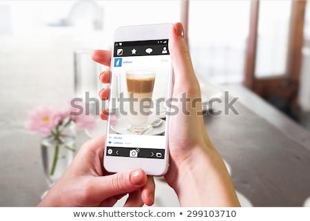 Composite image of hand holding smartphone Stock photo © wavebreak_media