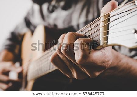 közelkép · kéz · játszik · gitár · gitáros · élet - stock fotó © artfotoss
