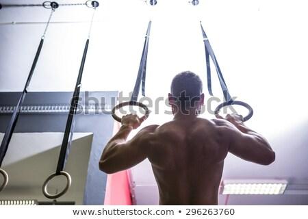 muscular man doing ring gymnastics stock photo © wavebreak_media