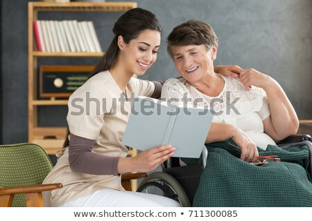 Old Lady Reading Book On Armchair In Hospice Stock photo © diego_cervo
