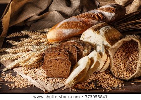 Friss búza kenyér fából készült tányér közelkép Stock fotó © jordanrusev
