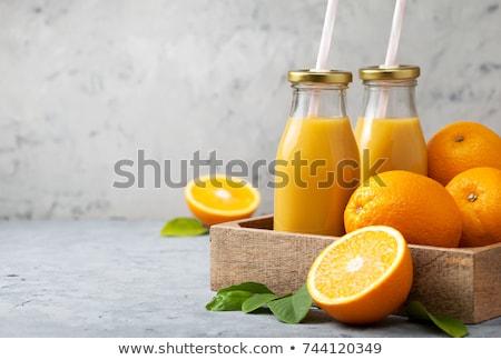 şişe taze portakal suyu natürmort olgun sulu Stok fotoğraf © dariazu