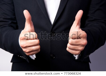 Gaining bosses approval, businessperson gesturing thumb up Stock photo © stevanovicigor