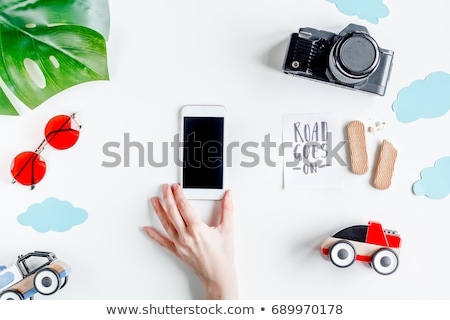 top view mockup of hands with mobile phone and card stock photo © stevanovicigor