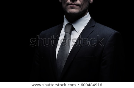 side portrait of an elegant business man in suit stock photo © feedough