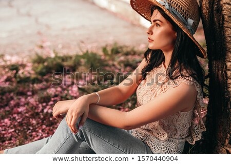 Thoughtful chic young woman sitting on the ground Stock photo © dash