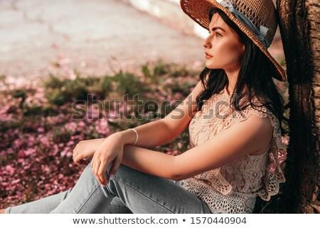 belo · sensual · mulher · sessão · parede · de · tijolos · sorrir - foto stock © dash