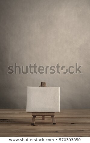 Blank Canvas and Easel on Wood Planking Stock photo © frannyanne