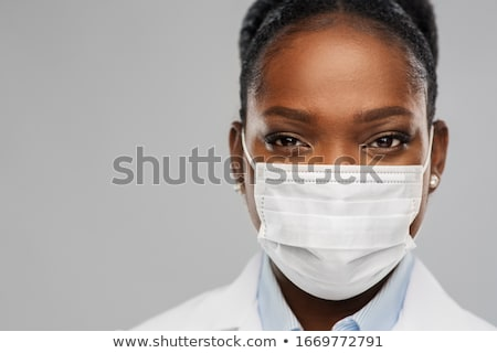 Foto stock: Close Up Portrait Of Young Woman Doctor In Mask