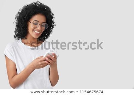 Portré mosolygó nő tart szemüveg téglafal nő Stock fotó © wavebreak_media