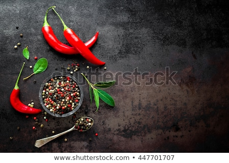 red hot chili pepper corns and pods on dark old metal culinary background Stock photo © yelenayemchuk
