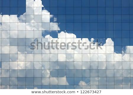 Kék irodaház felhők tükröződés modern üzlet Stock fotó © artjazz