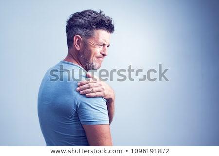 Handsome man with shoulder pain Stock photo © wavebreak_media