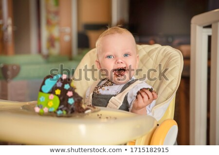 young mother with baby eating cake stock photo © is2
