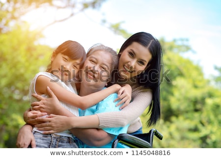 grandmother mother and daughter garden stock photo © is2